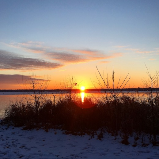 Sunset over a lake in winter